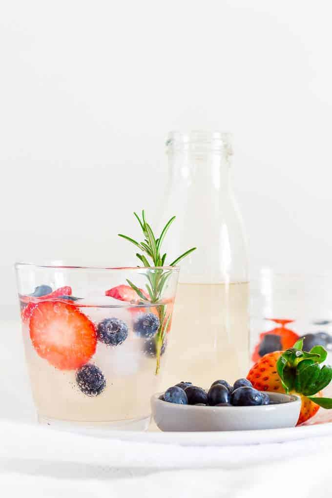 frity lime ginger beer Spring mocktail in a glass with rosemary