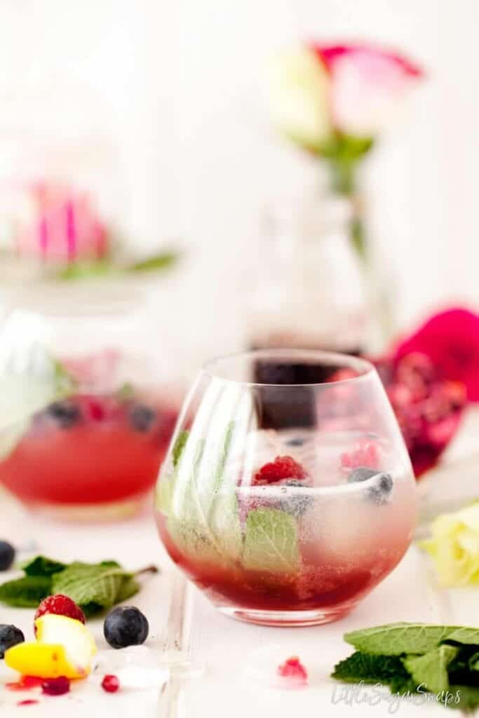 Sparkling Pomegranate Lemon Spring Mocktail, with raspberry and mint in glass